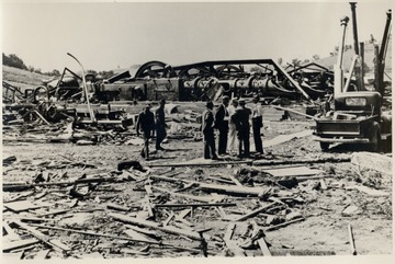Men inspect the ruins of the Bridgeport Station after a tornado.