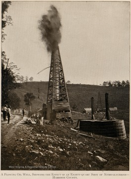 A flowing oil well, showing the effect of an eighty-quart shot of nitro-glycerine.  Harrison County.