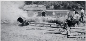 Men working on oil pipe.