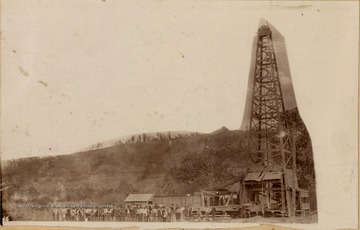 Large group of people gathered by the Big Moses Gas Well.