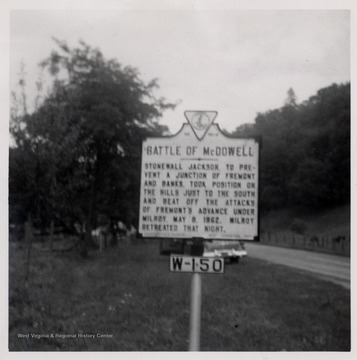 Road sign reading:  'Battle of McDowell  Stonewall Jackson, to prevent a junction of Fremont and Banks, took position on the hills just to the south and beat off the attacks of Fremont's advance under Milroy.  May 8, 1862.  Milroy retreated that night.'  Highland County, Va.