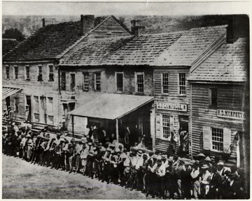 Men line up to volunteer across from the Court House, at Carrico Corner - High and Walnut Street, Morgantown, W. Va.