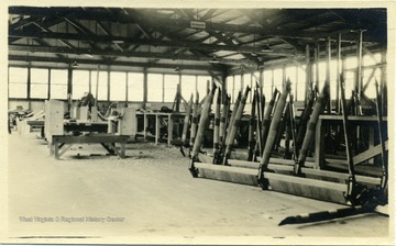 World War I era airplane landing gear lined up in a hangar.