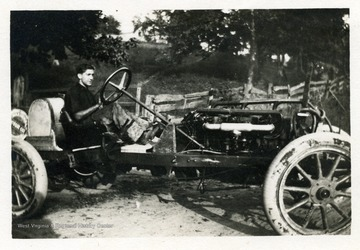 Louis Bennett, Jr. driving his car at approximately age 12.  See 'Cross and Cockade Journal' vol. 21, no. 4, winter 80 (West Virginia Collection Pamphlet no. 14277) for an identification on candid portrait of Bennett in car.