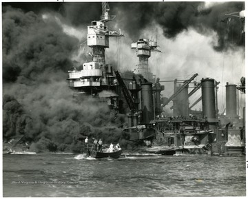 Picture of crew rescuing men of the U.S.S. West Virginia during the attack on Pearl Harbor. Credit Line Navy Department 80-G-19930.