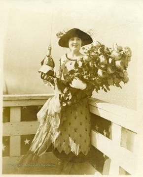 Portrait of Alice Wright Mann holding a bouquet and a bottle before the christening of the U.S.S. West Virginia.