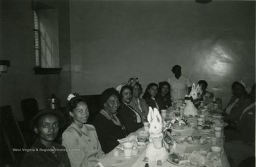 Picture of the Y.M.W. luncheon which took place at the Memorial Building in Kimball, McDowell County, Monday, March 27th, 1950 at 1 o'clock. The luncheon was free and the purpose of the meeting was to discuss plans for organizing Older Youth Groups. The age limits for YMW club membership was approximately 18 to 30. Married and unmarried young people are eligible. In every community there was a need for a program to bridge the gap between organized junior programs and the homemakers program and to include both men and women.