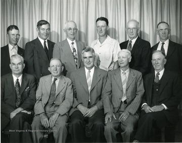 Group portrait of the Directors of the Harrison County Farm Bureau in 1947. Front row 'left to right' - C. M Sperry, President; John Wilcox; J.M Pierpoint, County Agent; Chas. B. Stout; and W. Ira C. Hawker. Back Row: Ernest Huffman, Lewis C. Swisher; Paul S. Horner; John W. Eib, Jr., Vice-President; H. E. Southern; and Jos. G. Lucas.