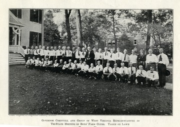Group portrait of Governor Cornwell and West Virginia Representatives to tri-state meeting of boys' farm clubs. Taken on lawn of executive mansion.
