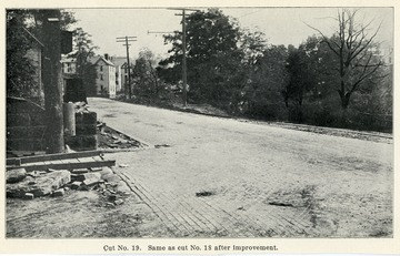 Picture of a road intersection. Cut No. 19 was the same as No. 18 after improvement. From the Report of the W. Va. State Board of Agriculture for the Quarter Ending Sept. 30, 1908.<br />