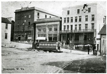 Picture of a intersection of streets in Monongah, W. Va. 1907.  Trolley car in the foreground.