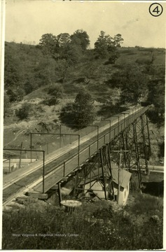 Bridge over a valley leading to a mine entrance.