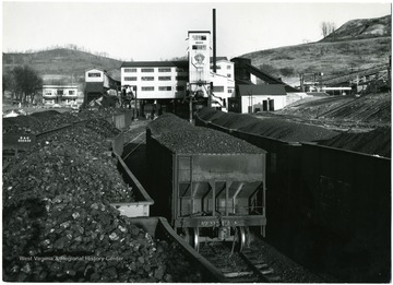 Full loads of coal in train cars in front of the C.C.C. Preparation Plant in Fairmont, W. Va. Credit must be given to William Vandivert, 21 East Tenth St., New York 3, N.Y.