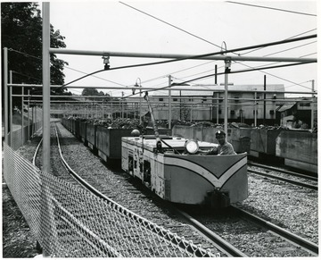 Miner driving an electric locomotive in a Consol Coal Yard in W. Va.