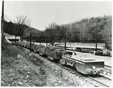 Filled coal carts leaving the Mathies Mine enroute to the Pittsburgh Consolidation Coal Co. Preparation Plant. Copy Print by 'Judge' of good pictures, 954 Liberty Ave. GR. 1-4288. AT. 1-3834.