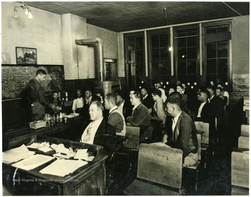 The first mining class being taught by U.G. Carter in Logan County, 1938.