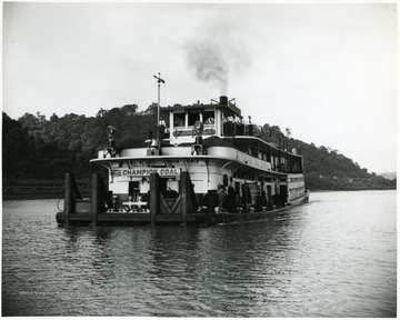 Champion coal tow boat of the Pittsburgh Coal Co. on unknown river.