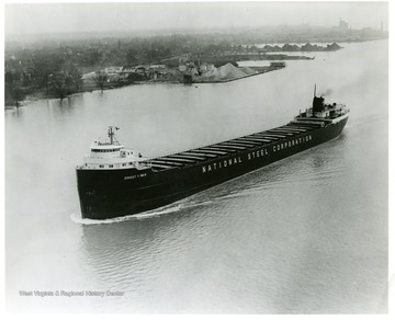 The National Steel Corporation ship in an unknown river. Ernest T. Weir is written on the side of the barge. Reorder No. from creator is 29786-3.
