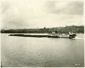 Pittsburgh Coal Co. towboat with a load of coal outside of an unknown city; R.J. Elinhart, Elizabeth, PA.