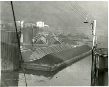 Multiple barges loaded with coal at Star City, W. Va.