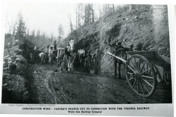 Men and horses stand in cut in hillside.  This construction work done by the White Oak Railway Co. was the Carter's Branch Cut to connection with the Virginia Railway.
