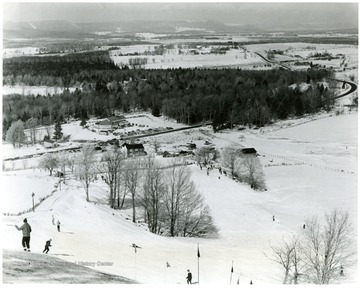 Caption on back reads, 'West Virginia, with the highest average elevation of any state east of the Mississippi River, is making a strong bid to become one of the nations leading winter sports centers. Snow covered mountain slopes like Cabin Mountain, pictured here, overlooking the Canaan Valley, see an average annual snowfall of over five feet. The state now boasts five major winter sports centers located in widely-separated locations.'