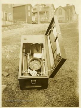 Open box with saw and other implements for use during a mine rescue operation.