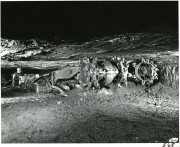 A continuous mining machine operating in a four foot seam.