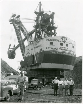 People standing next to the massive Mountaineer shovel.