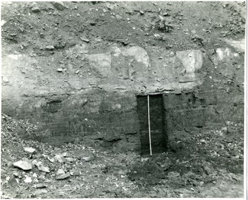This picture shows the thickness of the coal seam in relation to a normal doorway.