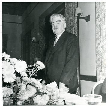 John L. Lewis standing behind a table during a Consolidation Coal Co. Inspection Trip.