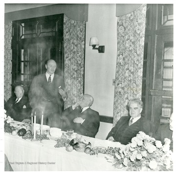 Official giving speech behind dinner table during Consolidation Coal Co.  Inspection trip in 1948.
