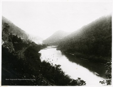 View of the river, railroad, and houses at Caperton, W. Va.<br />