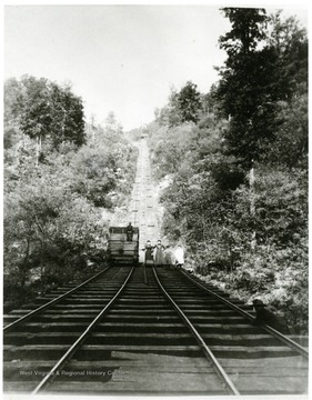 Women and children stand on the tracks below the New River Coal Company incline at Caperton, W. Va.