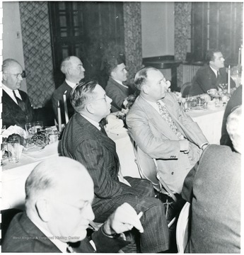 Coal officials listening to speech at dinner during a Consolidation Coal Co. Inspection trip.