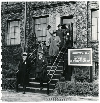 Coal officials leaving a restricted building of research and development during a Consolidation Coal Co. Inspection trip.