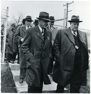 Coal officials walking down sidewalk stairs during a Consolidation Coal Co. Inspection trip.