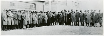 Group portrait of coal officials posing for picture during a Consolidation Coal Co. Inspection trip.