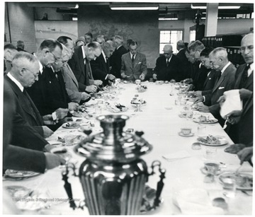 Group of officials at dinner table during a Consolidation Coal Co. Inspection trip.