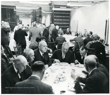 Coal officials eating dinner during a Consolidation Coal Co. Inspection trip.