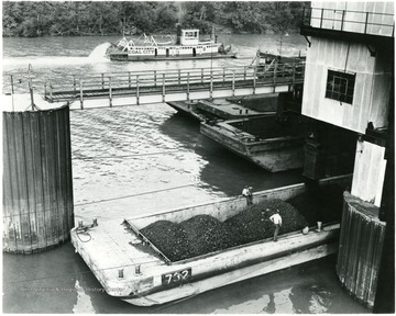 Coal barge on river being filled during a Consolidation Coal Co. Inspection trip.