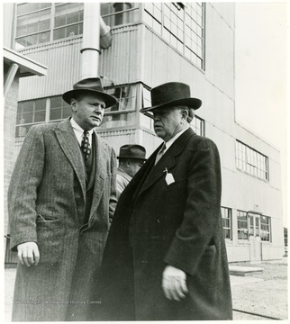 Two coal officials talking outside during a Consolidation Coal Co. Inspection trip.