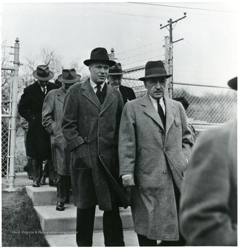 Group of men walking outside during a Consolidation Coal Co. Inspection trip.
