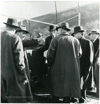 Coal officials talking outside during a Consolidation Coal Co. Inspection trip.