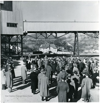 Group of miners and coal officials outside of mine building during a Consolidation Coal Co. Inspection trip.
