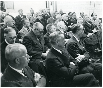 Group of coal officials sitting in chairs during a Consolidation Coal Co. Inspection trip.