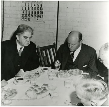 John Lewis at dinner with coal officials during a Consolidation Coal Co. Inspection trip.