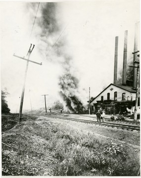 Caption on back reads, 'Fire in the ventilation system or fan house of the Gaston Mine, 1912.  This mine was opened by James Otis Watson in 1874. Located at Watson and closed in 1925. It was located in what is now the present boundary of the friendly city of Fairmont.'