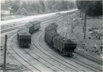 Loaded railroad cars on the tracks at Skelton show the famous White Oak Smokeless Coal.