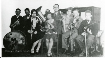 Group of people with instruments. 'Many NRC towns had own orchestras.'